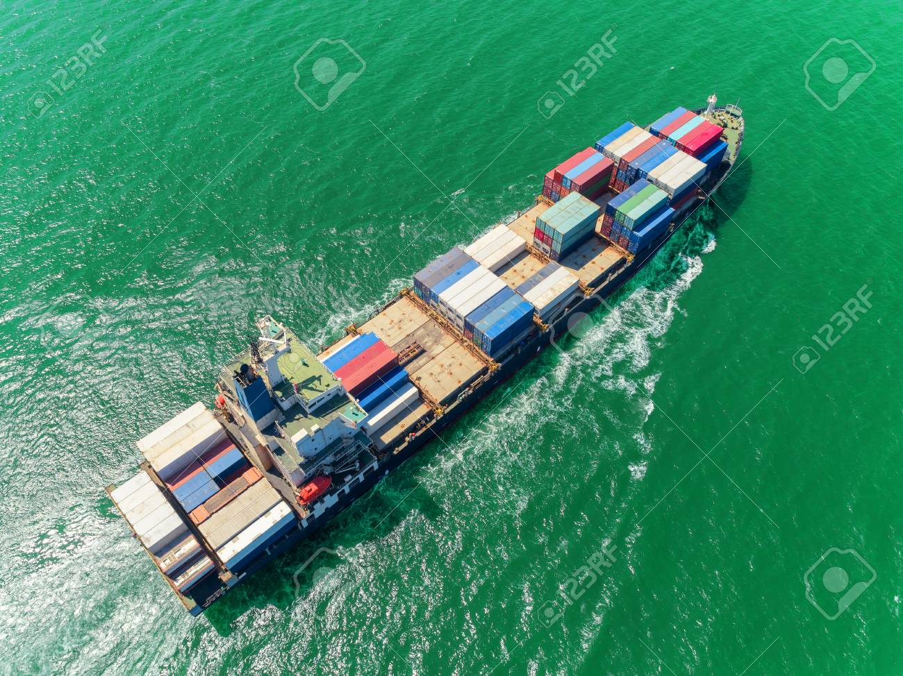 Aerial top view container ship at sea port loading container