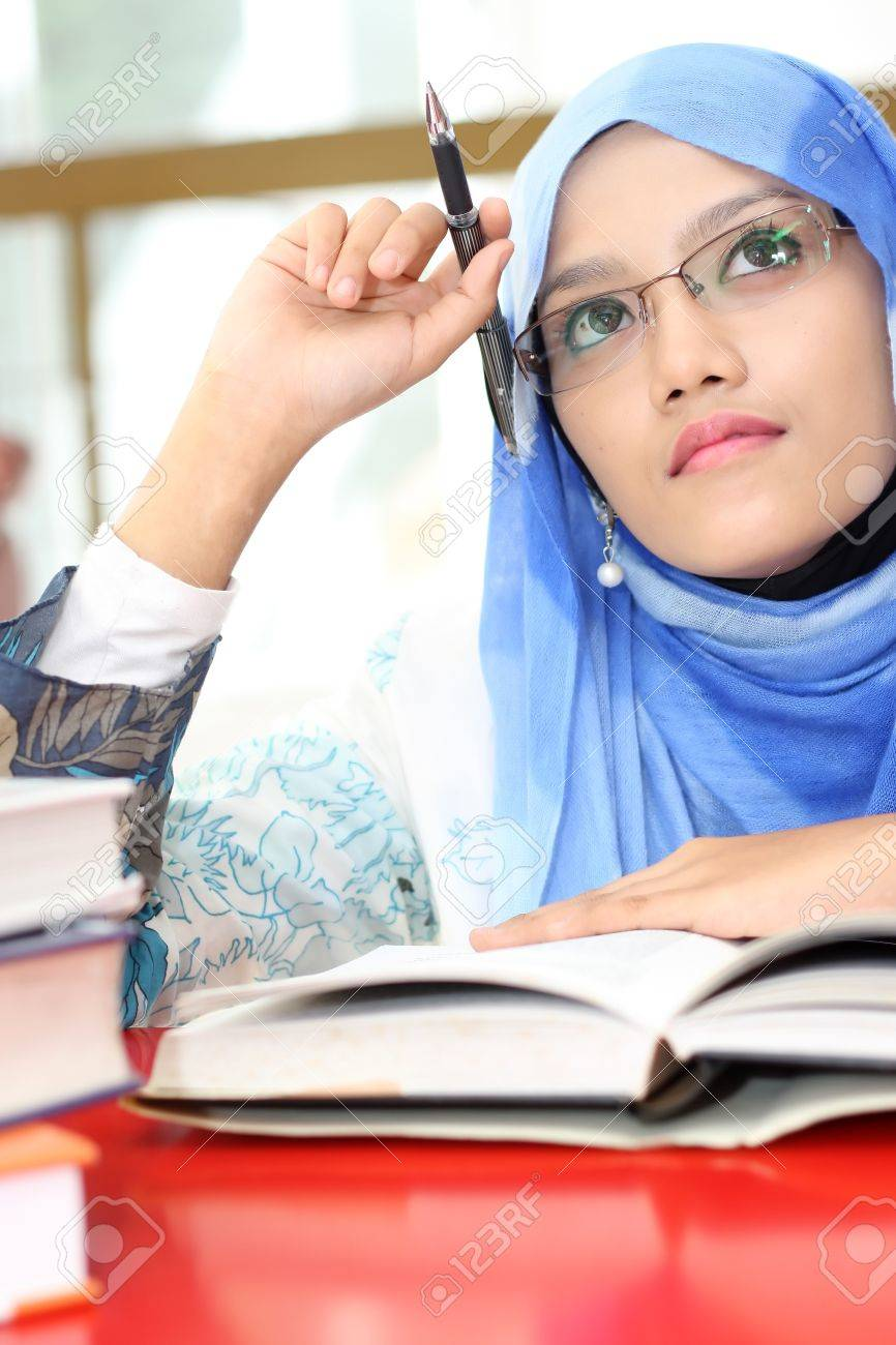 A young muslim girl was thinking Stock Photo - 10754866