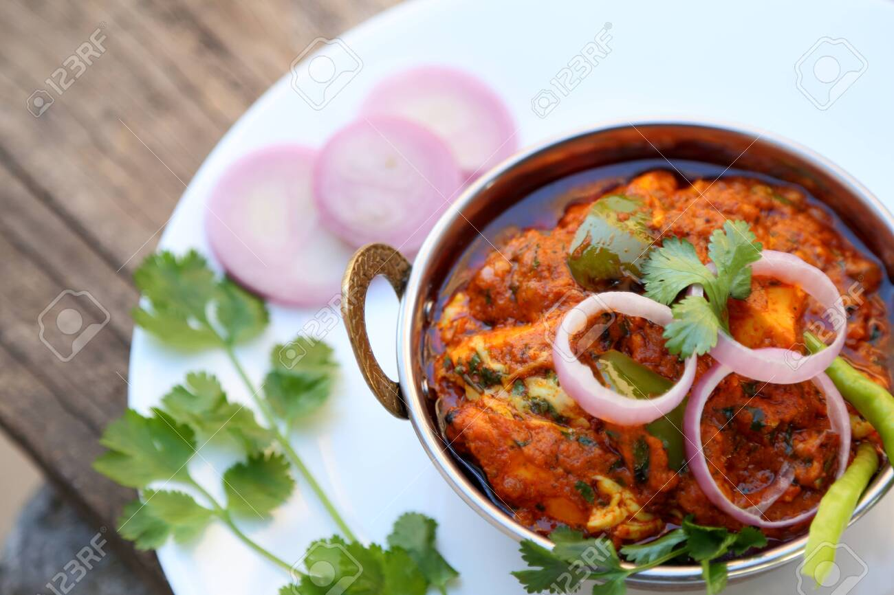 INDIAN STYLE COTTAGE CHEESE VEGETARIAN CURRY DISH. Kadai Paneer - Traditional Indian or Punjabi food. Garnished with onion and chili slices. - 149541710