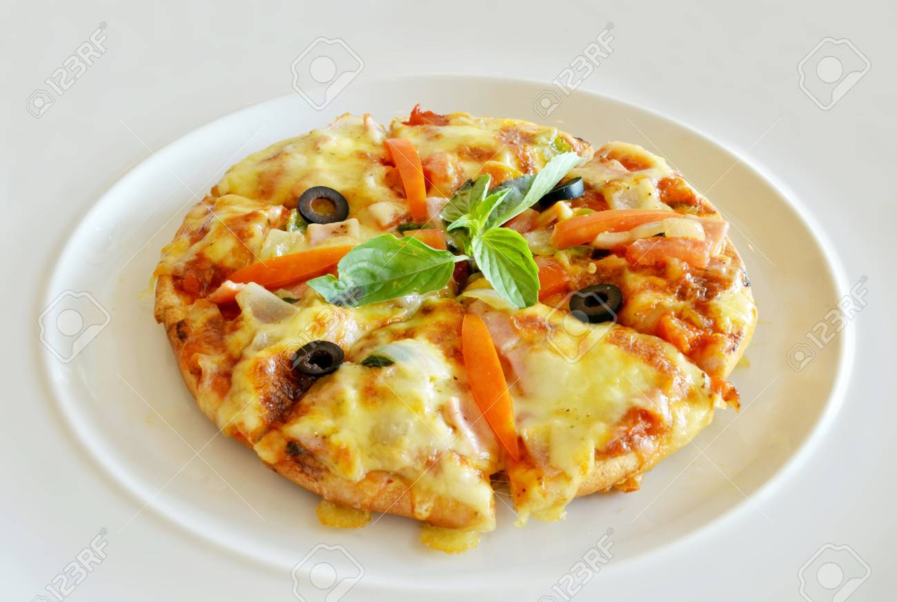 homemade pizza with ham and delicious cheese Stock Photo - 12911441