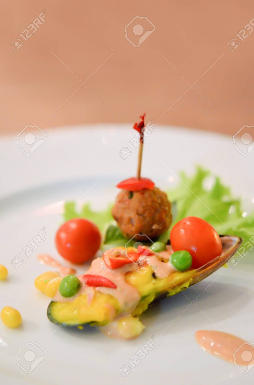mussels under cheese served  with fresh  vegetable and fried meat ball Stock Photo - 14010145