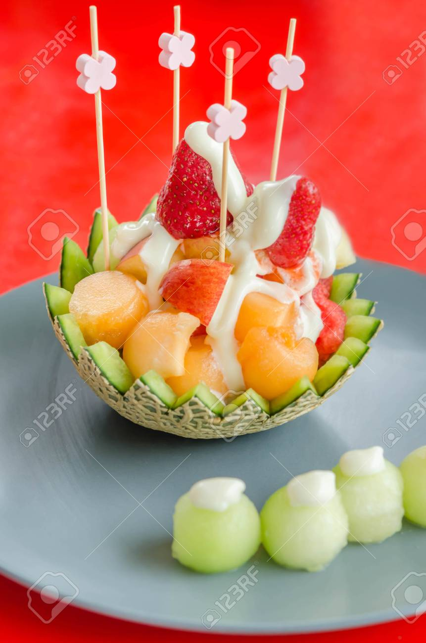 Fresh Fruit Salad In Cantaloupe Bowl On Dish Stock Photo Picture And Royalty Free Image Image 44372972 Healthy cantaloupe breakfast bowls filled with yogurt, granola, berries and a drizzle of honey. https www 123rf com photo 44372972 fresh fruit salad in cantaloupe bowl on dish html