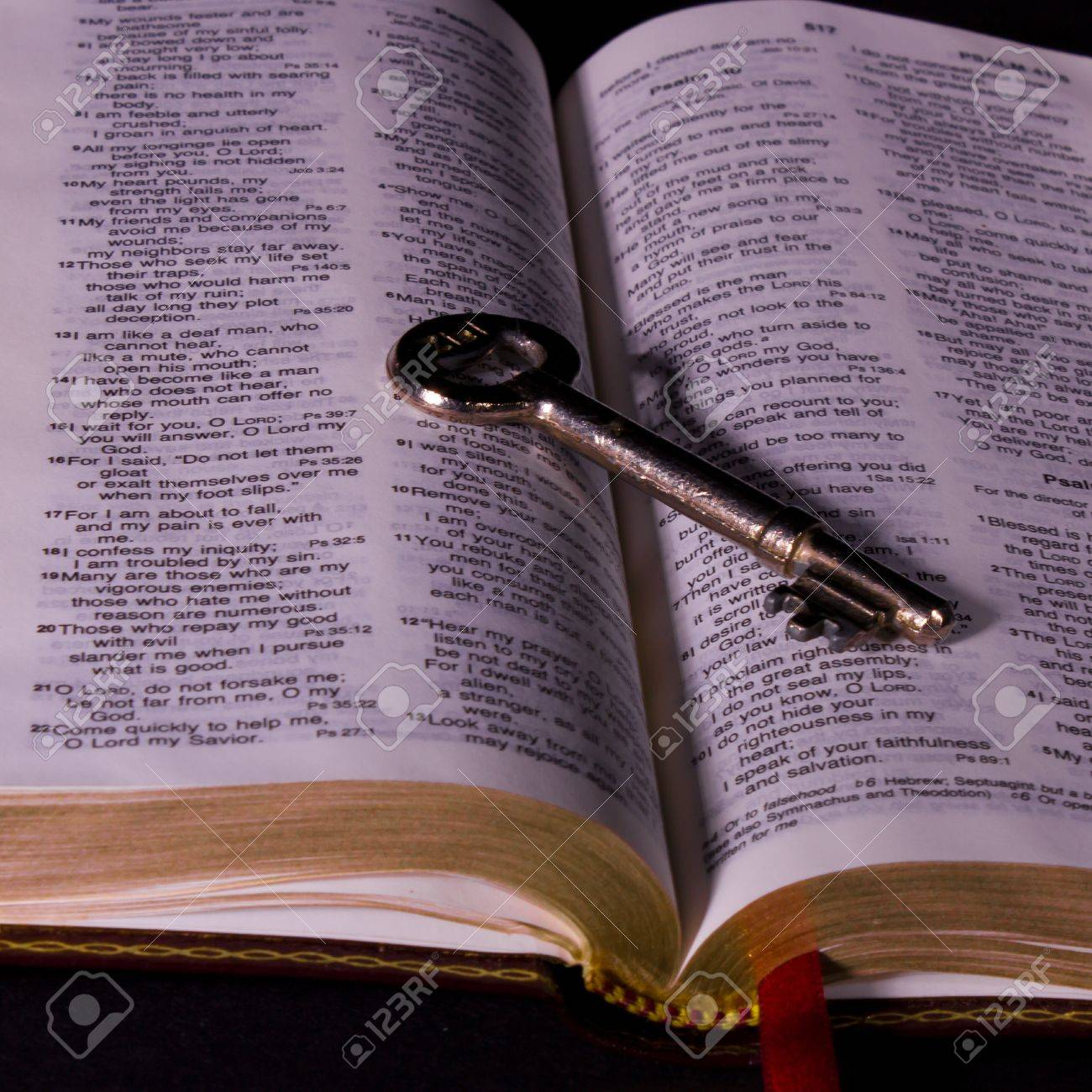 open holy bible and key stock photo picture and royalty free