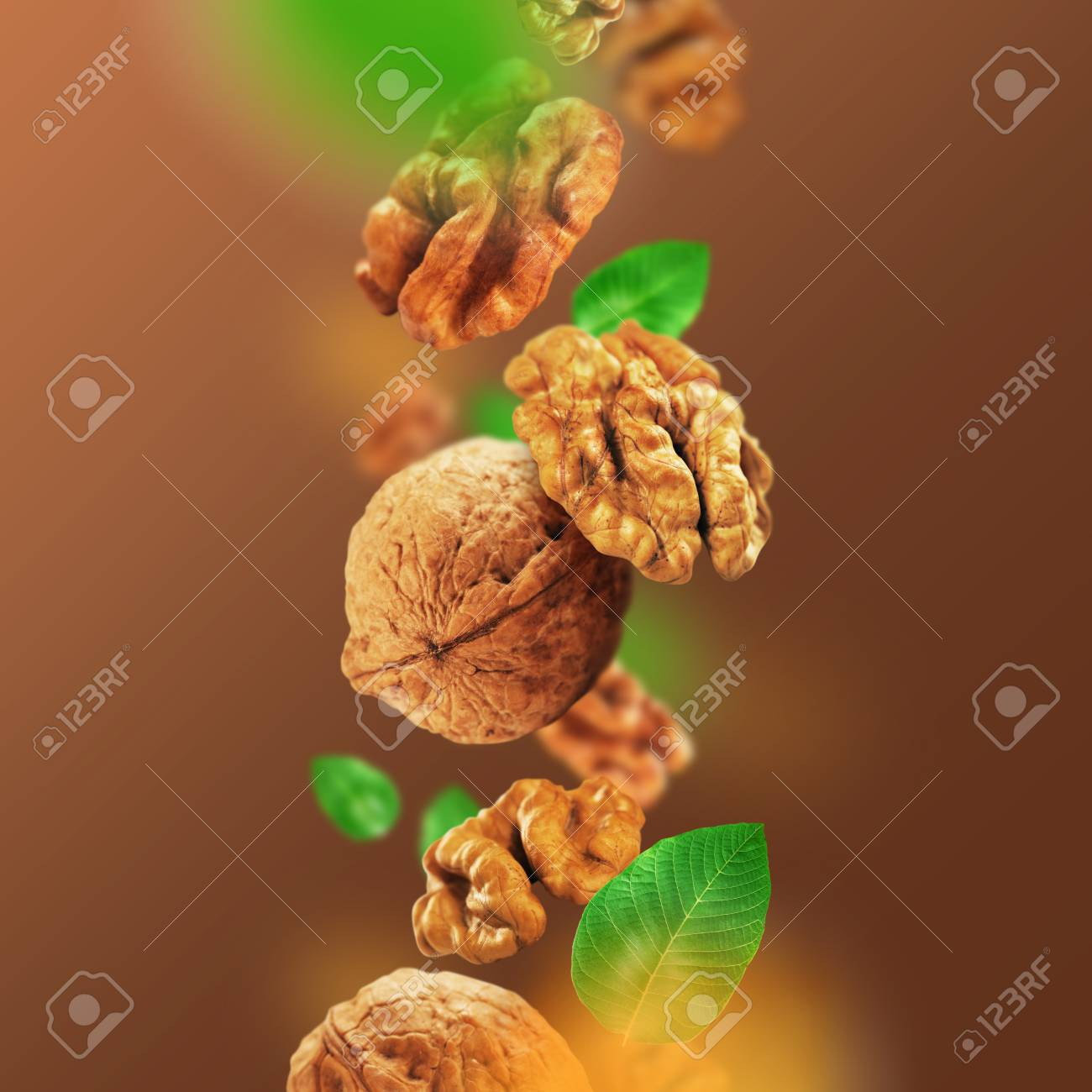 Walnuts and leaves falling from the air - 86784637