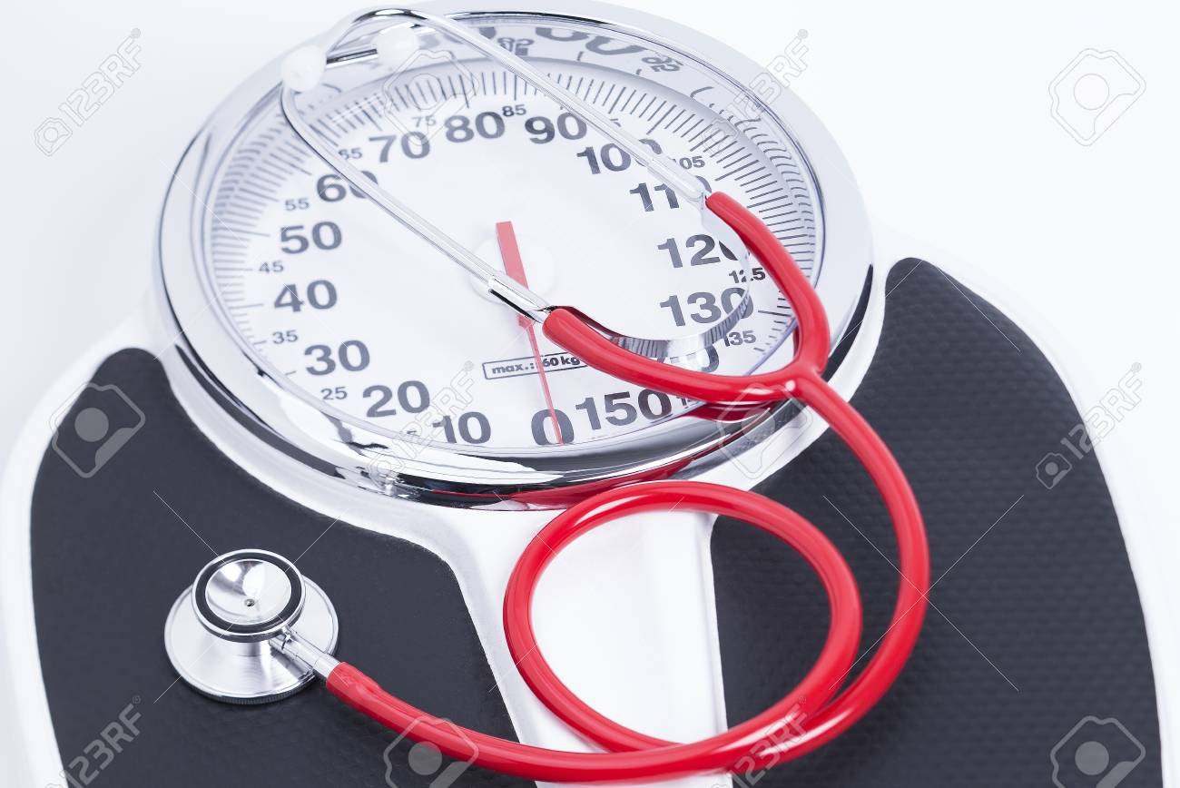 Image Shows Of Analog Bathroom Scales With A Stethoscope Stock Photo
