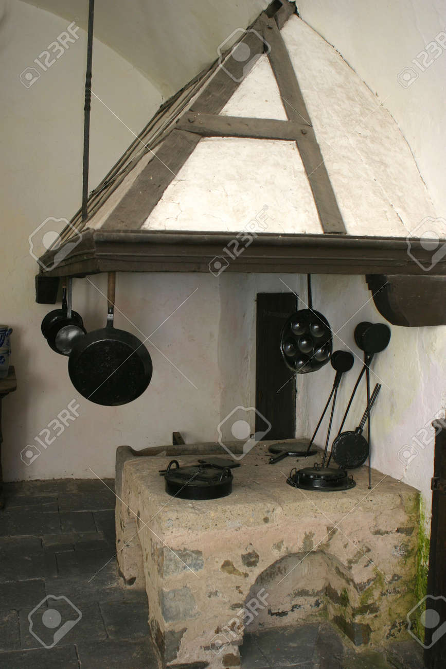 Old And Restored Kitchen Belonging To A Medieval Castle In Germany Stock Photo