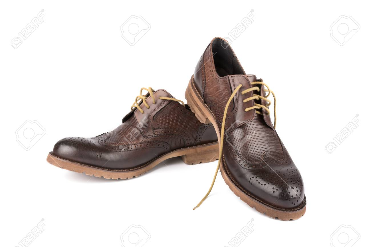 98f52e0be5 Pair of men s shoes. Expensive brown leather. Isolated Stock Photo -  55609243