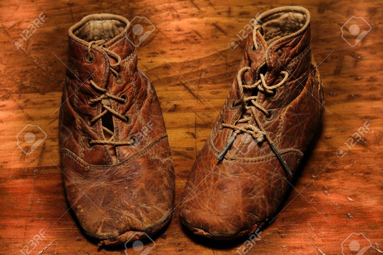 Worn Out Antique Leather Baby Shoes On