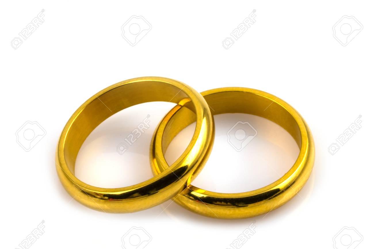 Goldene Hochzeit Ringe Auf Weissem Hintergrund Lizenzfreie Fotos
