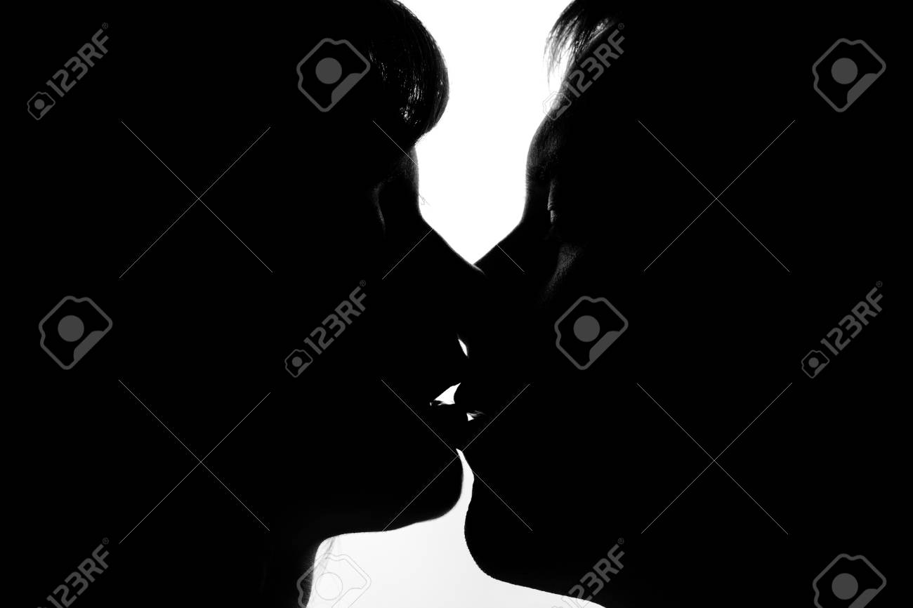 Black and white silhouettes of couples in love during a kiss stock photo 51422014