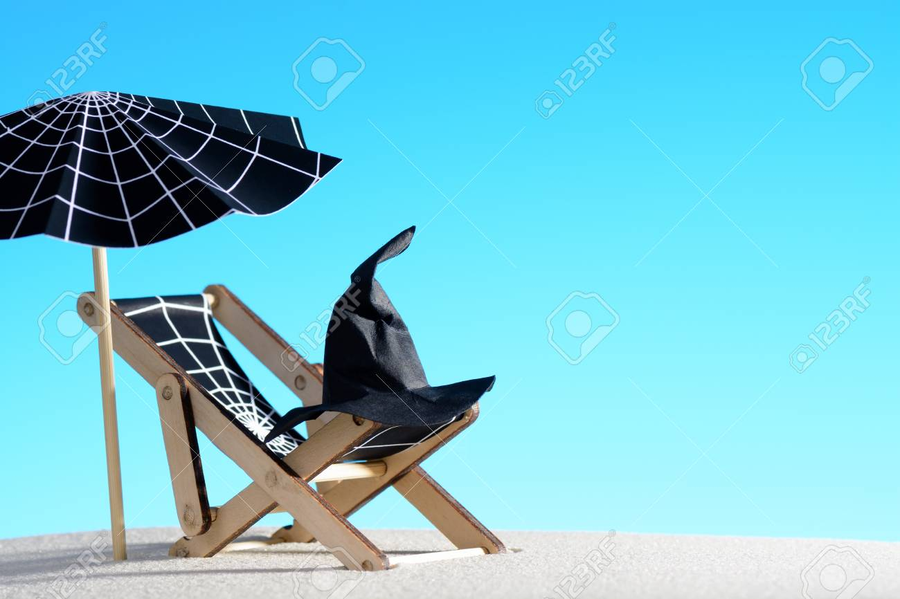 Lounge Chair And Umbrella With Spider Web On Sand Stock Photo   85140736
