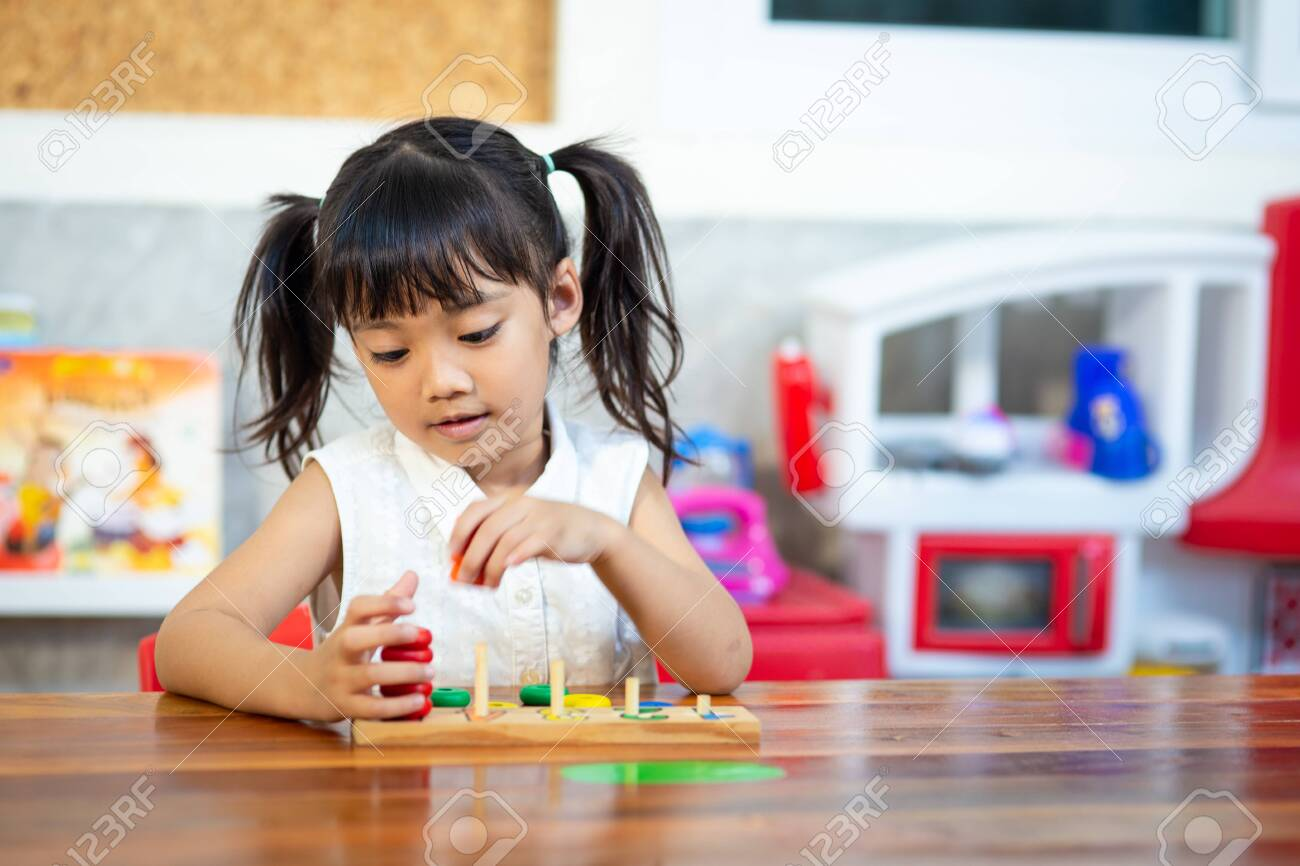 child little girl playing wooden toys - 147130226