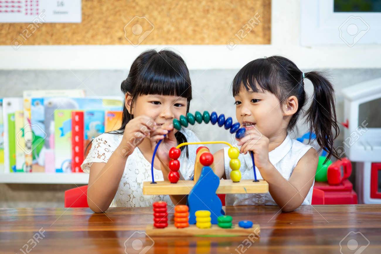 child little girl playing wooden toys - 147130389