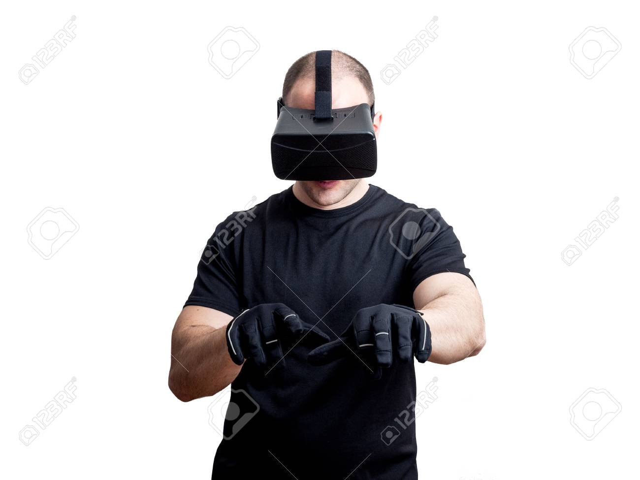 282dd7a4a186 Man using virtual reality headset at work with gloves isolated on white  background Stock Photo -