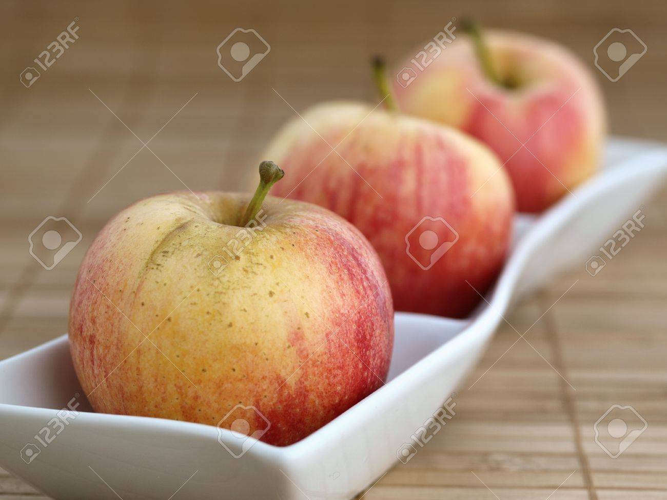 Three apples in a  white bowl Stock Photo - 16039873