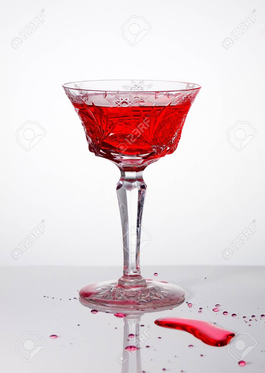 wine glass and spilled wine splash forming stock photo picture and