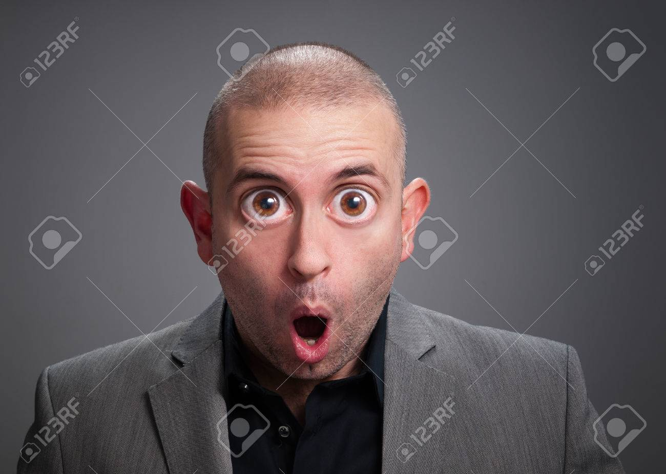 Businessman with surprise expression The photo has a digital retouching with eyes wide open - 24357272