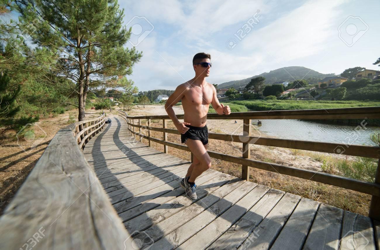 Man running in a promenade outdoors. Man is training - 45571294