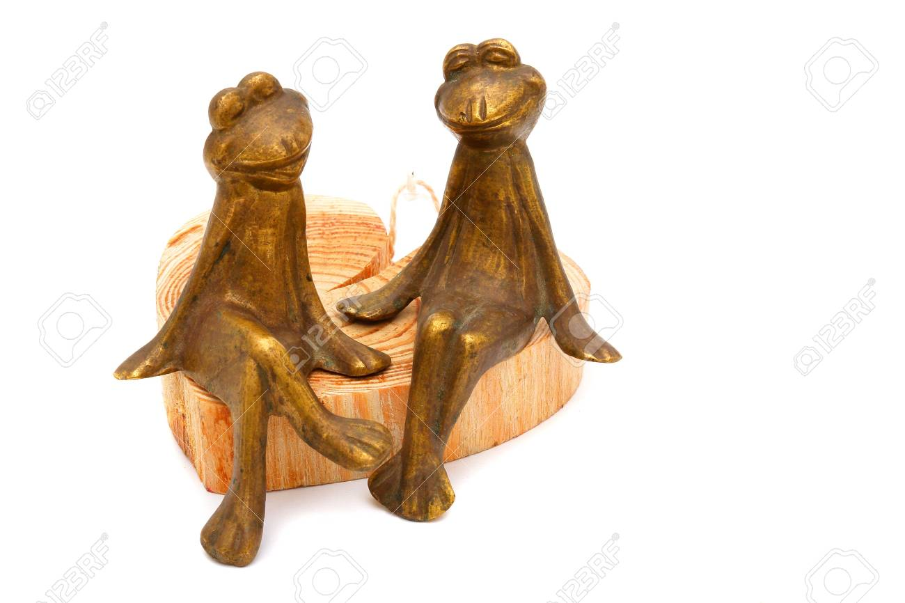 Frogs of bronze on a white background Stock Photo - 6623516