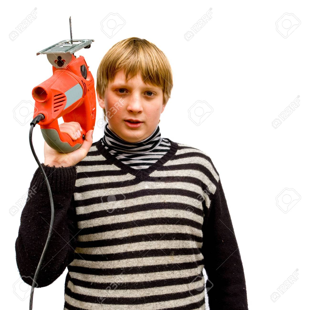 Boy with a fret saw on a white background Stock Photo - 6683864