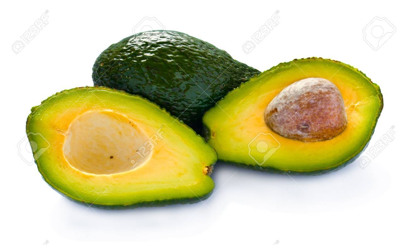 Avocado cut in half against white background Stock Photo - 12187049