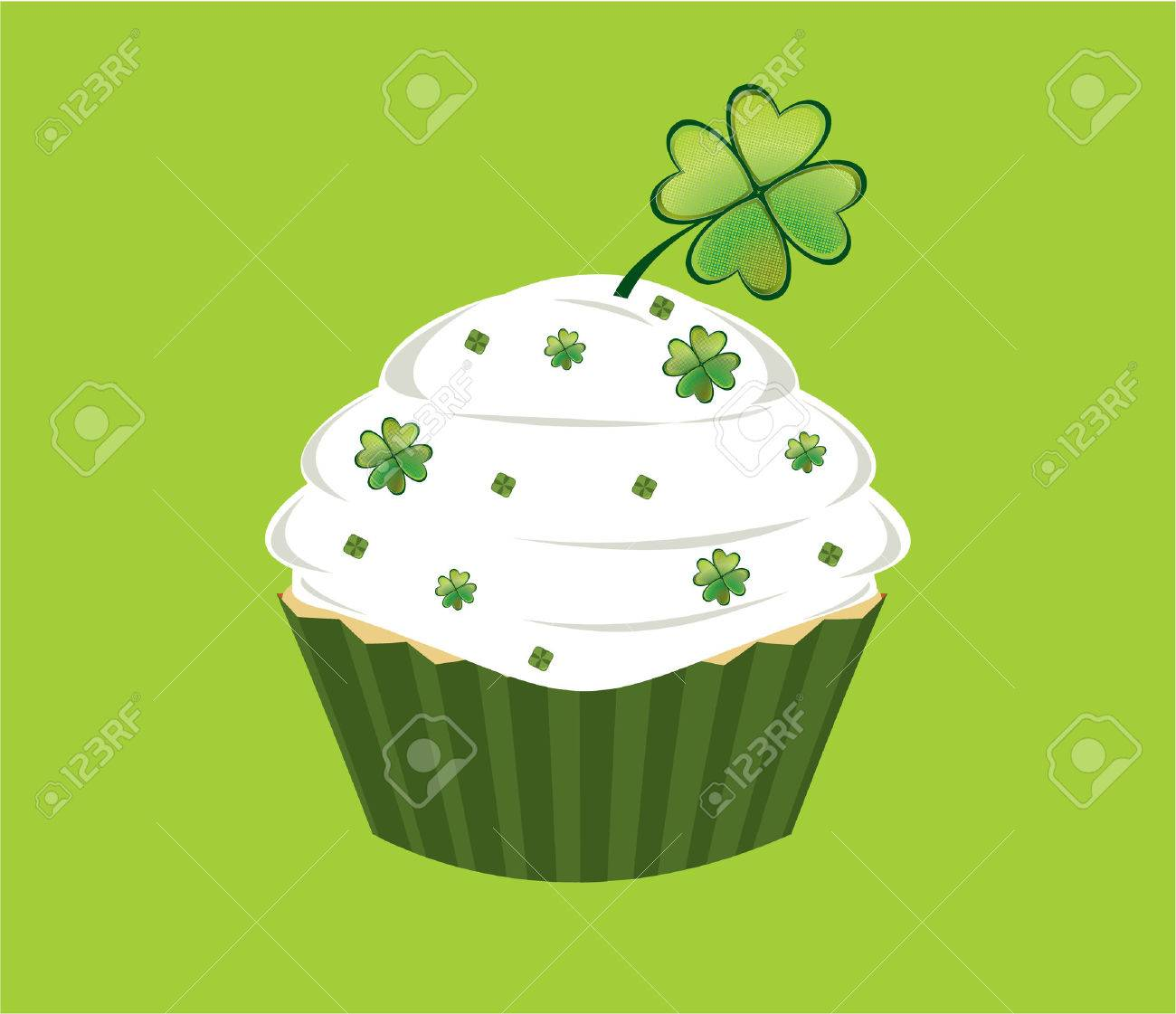 Cupcake decorated with green diamond shapes and shamrocks on white frosted in front of a white background - 6468320