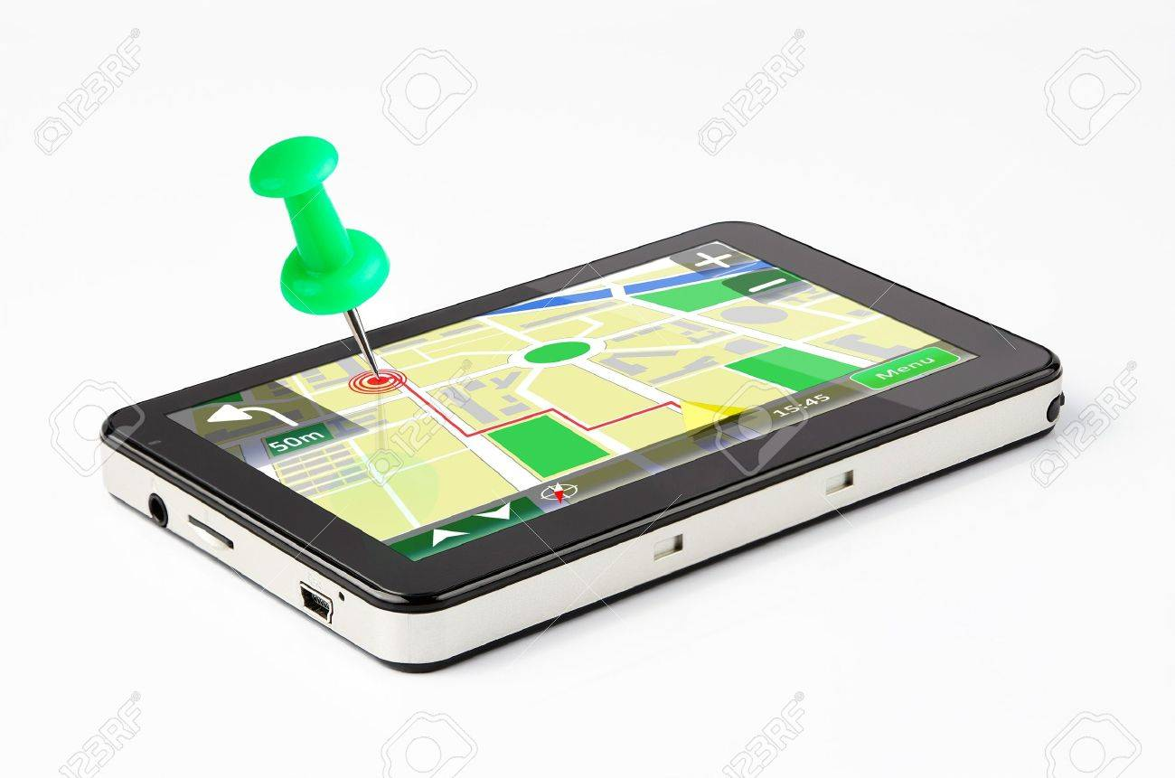 Travel destination, green pin stuck in a GPS device Stock Photo - 10244620
