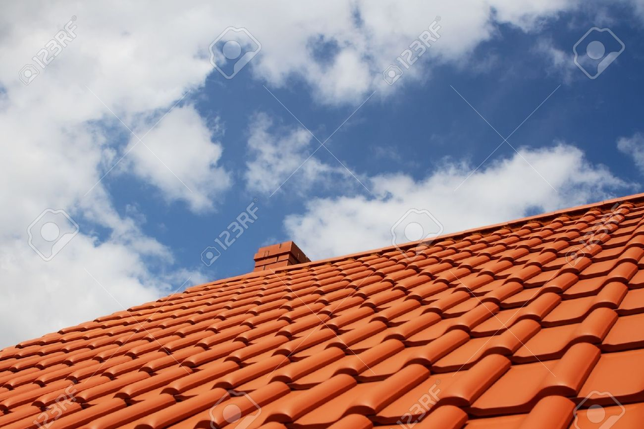 Brand new red rooftop against blue sky Stock Photo - 10425419