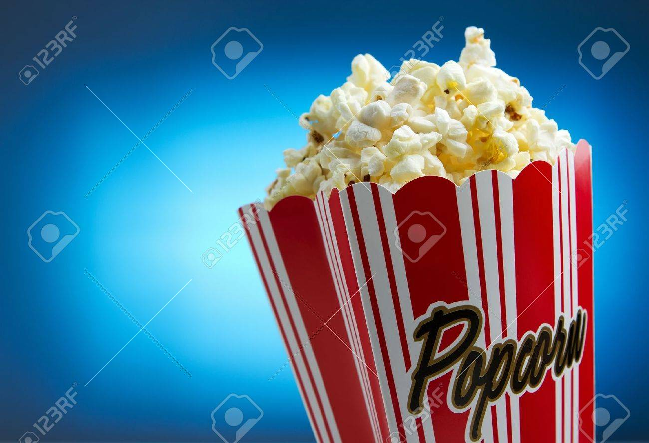 Popcorn over blue background, movie concept Stock Photo - 10425418