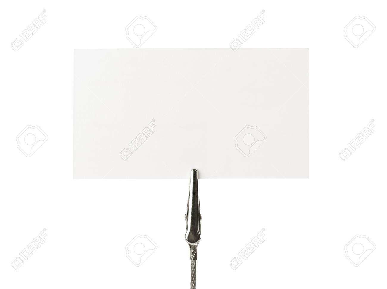 Blank business card on a clip over white background Stock Photo - 10875298