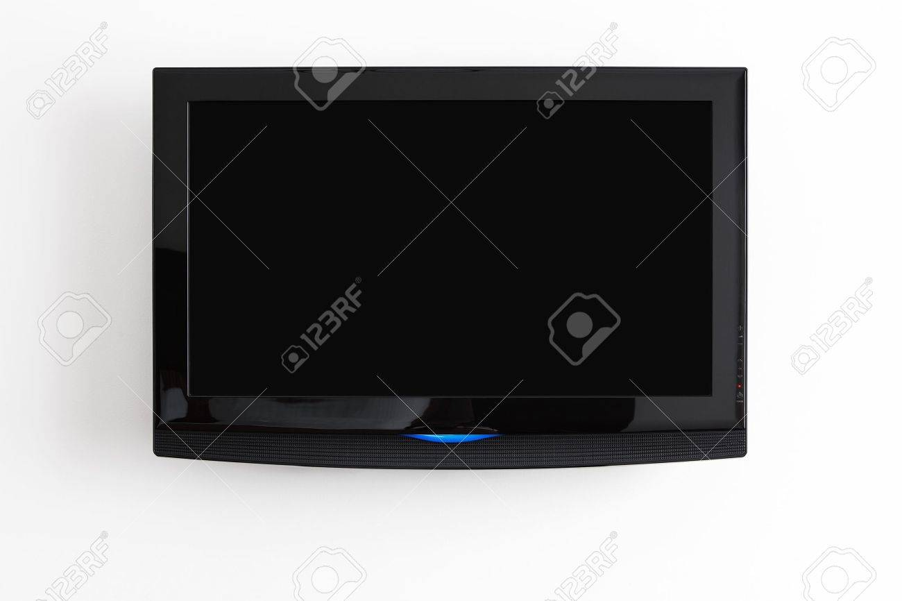 Flat screen LCD hanging at the wall with clipping path for the screen Stock Photo - 11112168