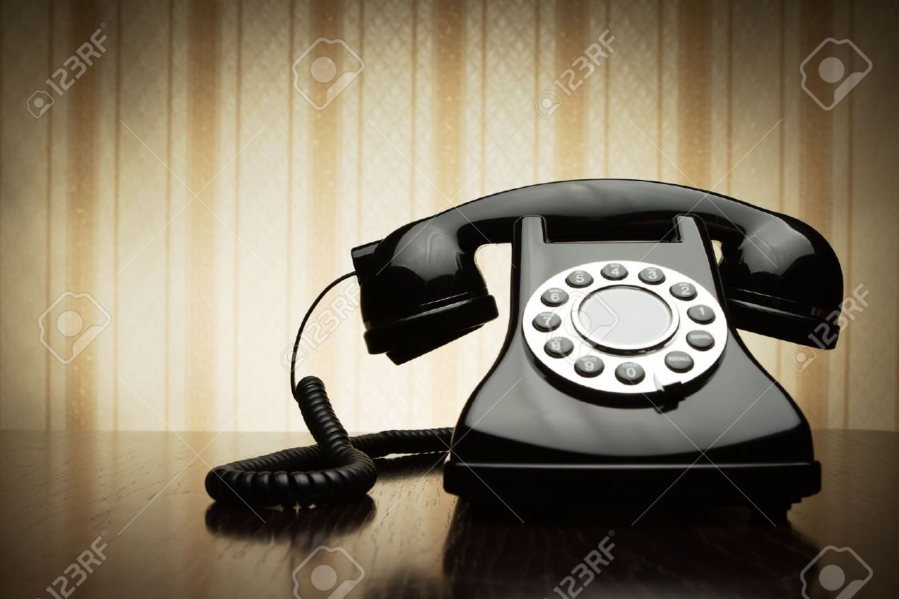 Vintage telephone over striped wallpaper Stock Photo - 11556793