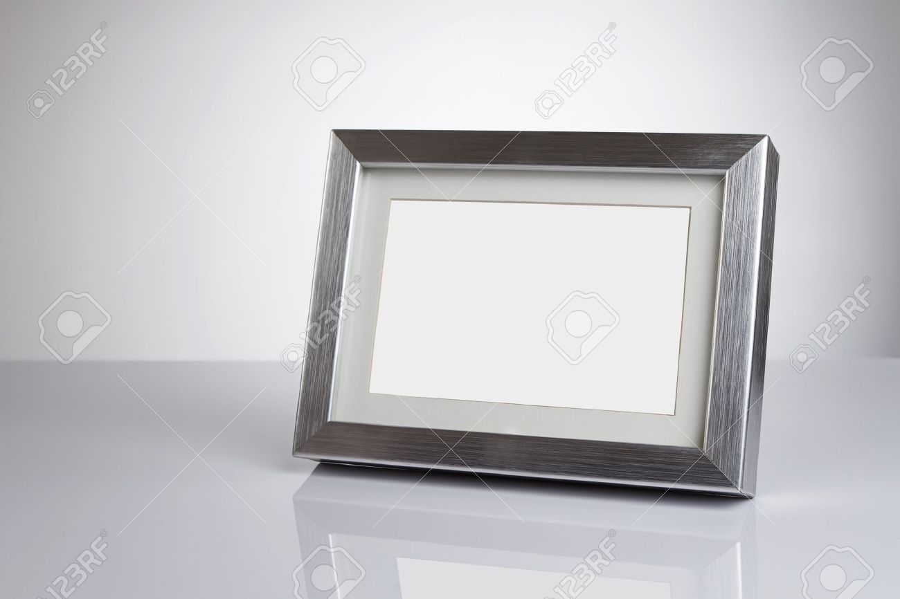 Blank Silver Picture Frame At The Desk With Clipping Path Stock ...