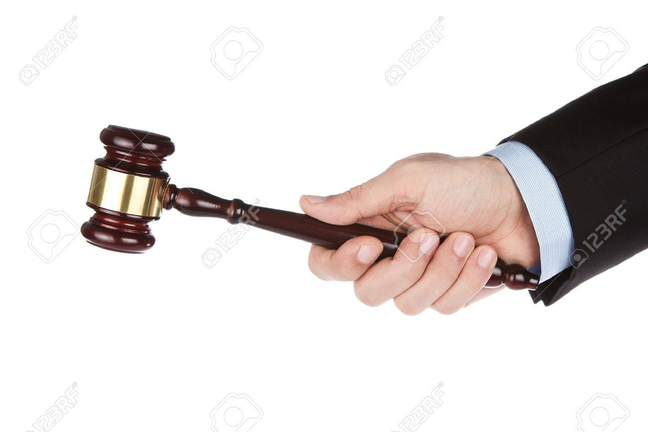 Male hand holding wooden gavel isolated on white background Stock Photo - 12049437