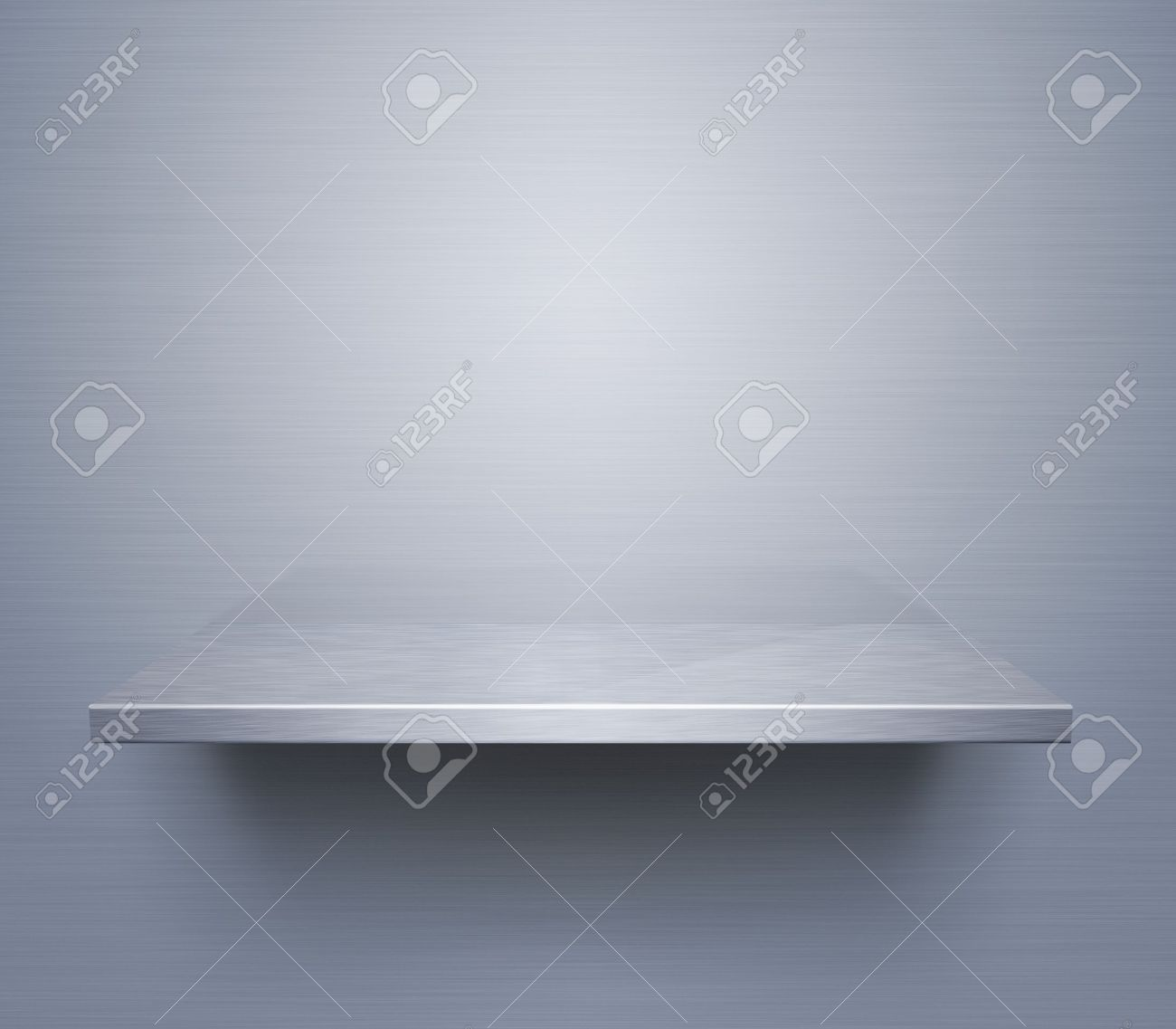 Empty brushed metal shelf at the wall Stock Photo - 12538337