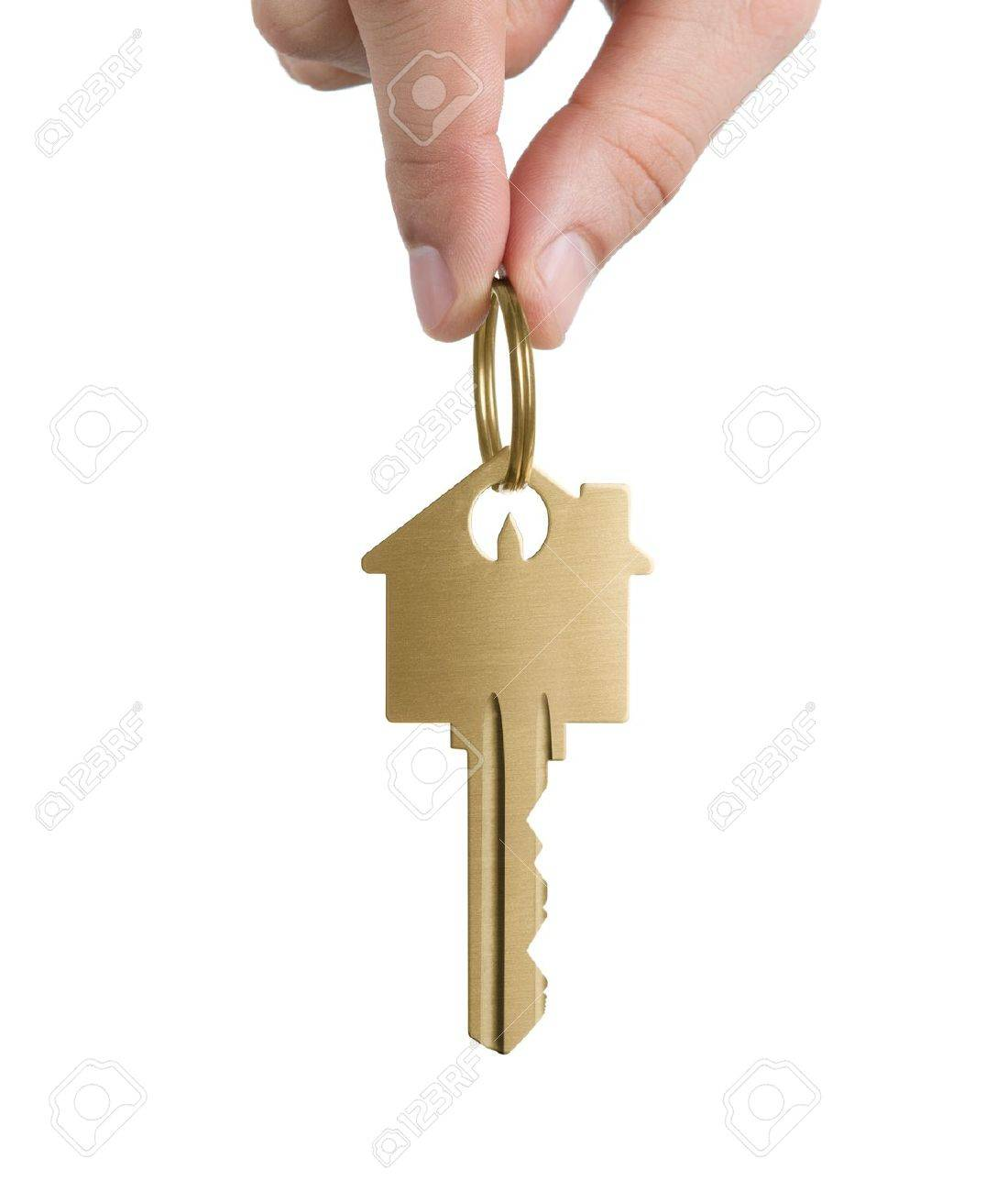 Human Hand Holding Key To A Dream House Isolated On White Background Stock Photo - 12538614
