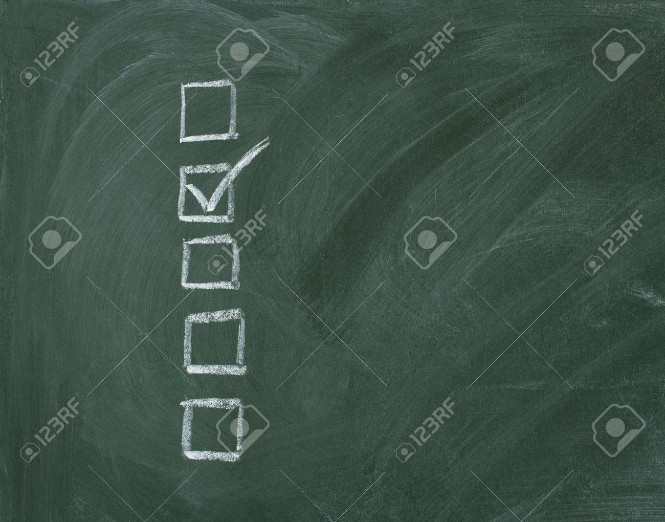 Checklist at the blackboard with copy space Stock Photo - 12863513