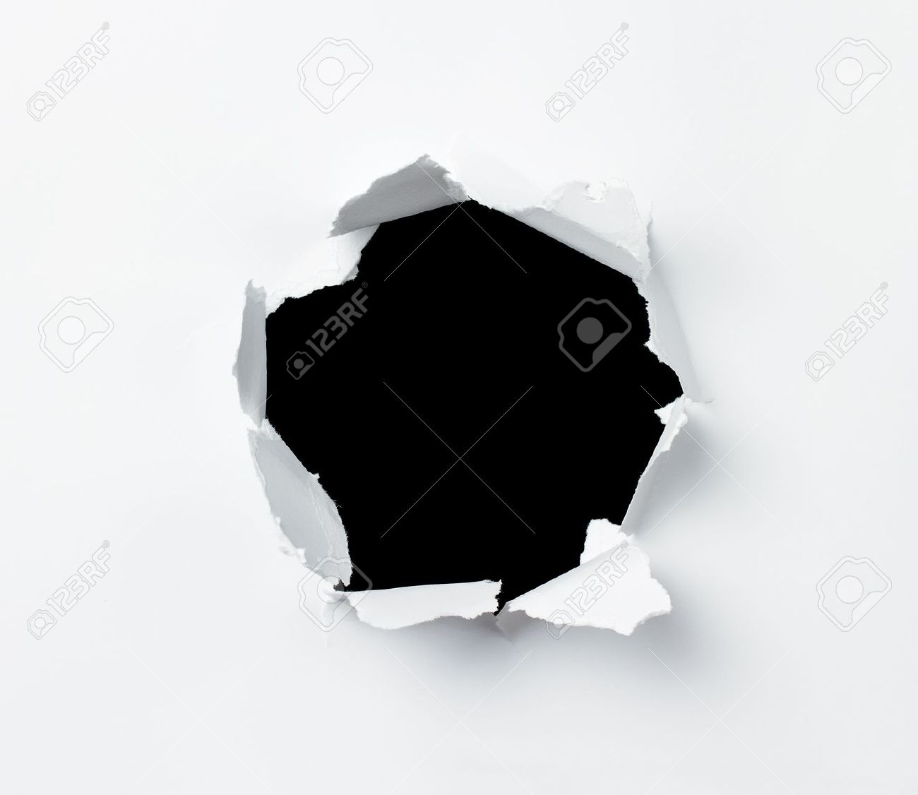 Hole punched in the paper sheet Stock Photo - 12863514