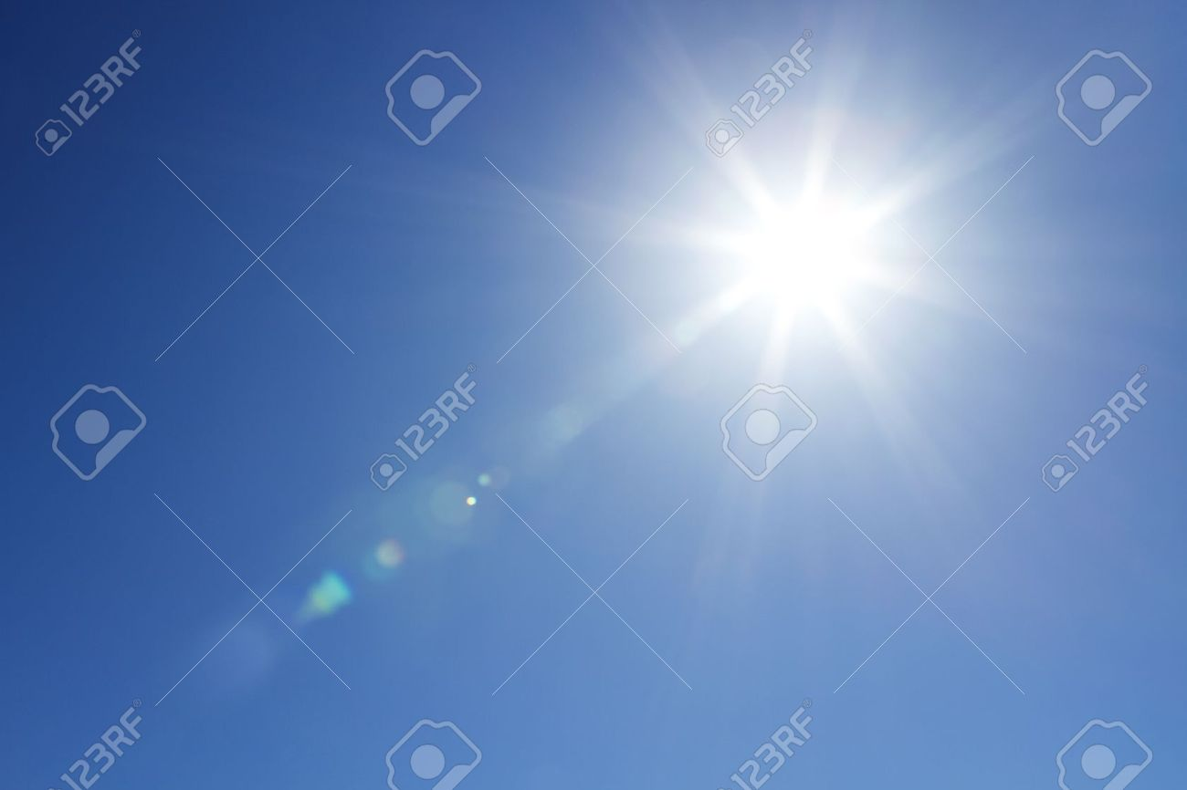 Sun with bright beams at the clear blue sky with copy space Stock Photo - 13414728