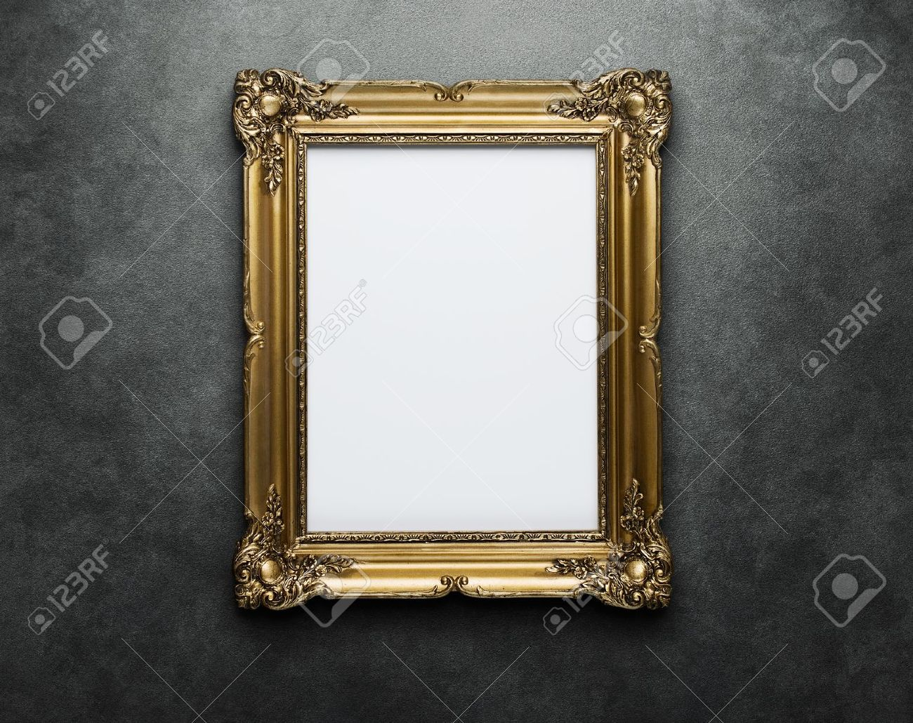 ornate gold frame at the concrete wall with clipping path for the inside stock photo