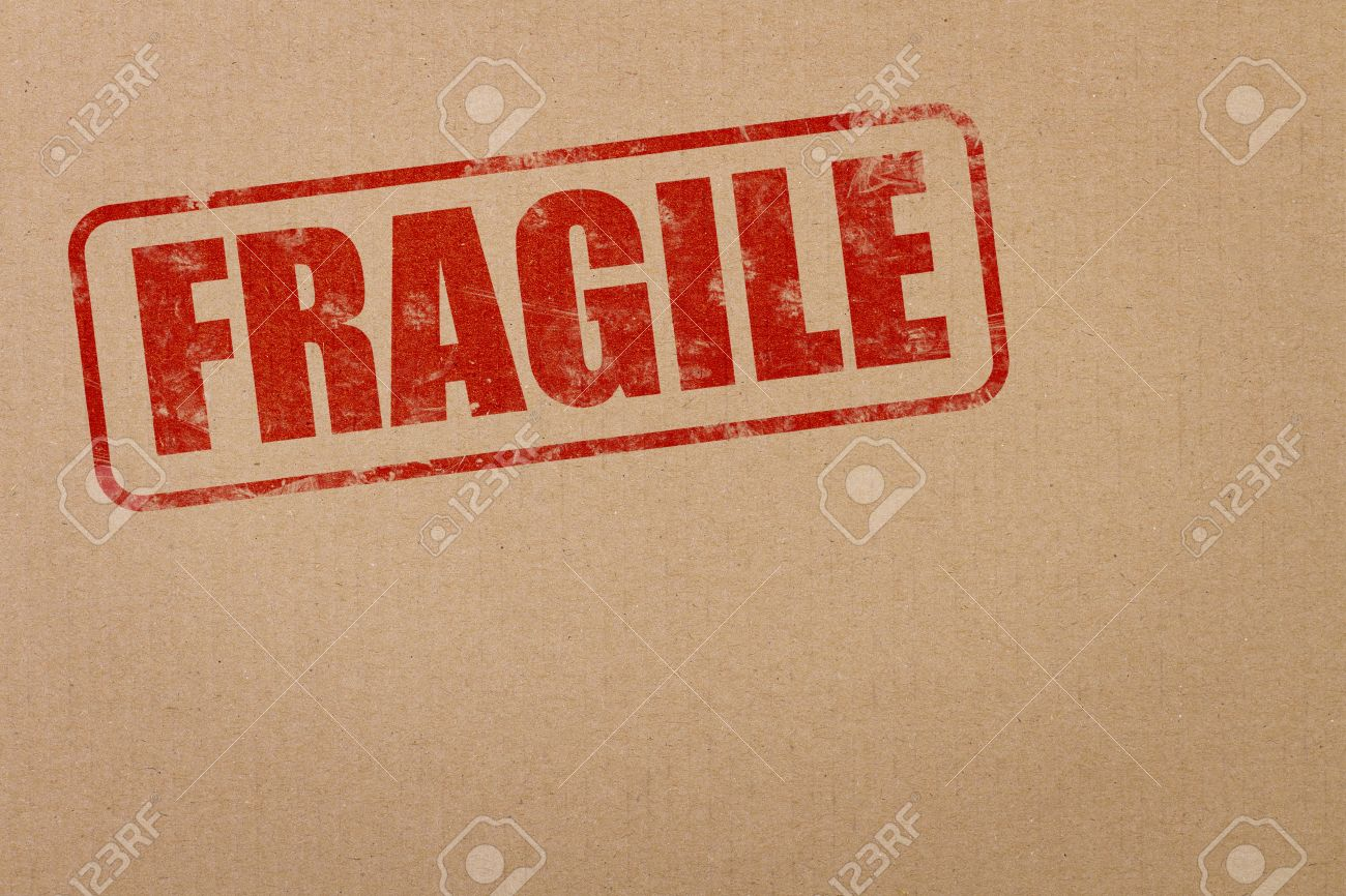 Fragile Stamp On Cardboard Box With Copy Space Stock Photo