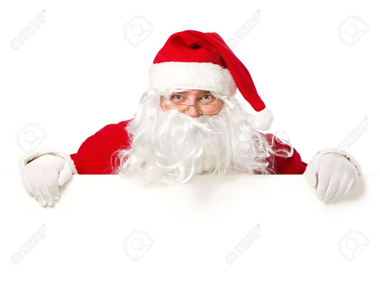 Happy Santa Claus looking out from behind the blank sign isolated on white background with copy space - 16519317