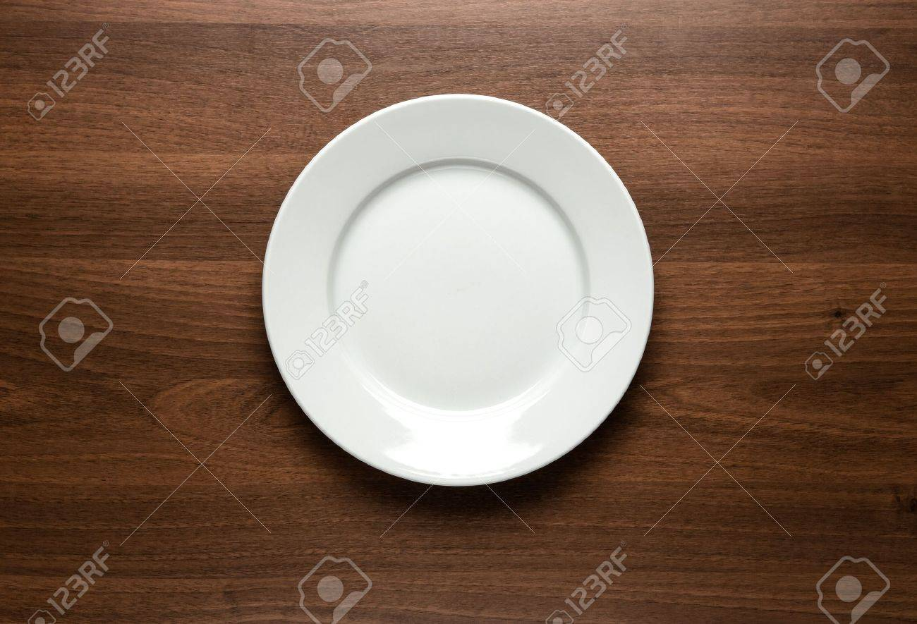 Close up of white empty plate at the wooden table with copy space Stock Photo - 18466224