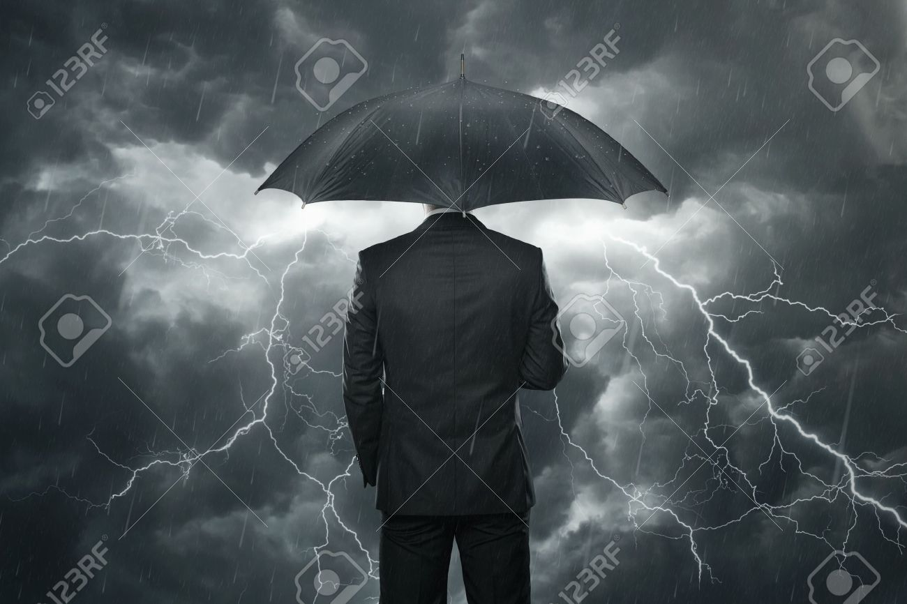 trouble ahead concept businessman with umbrella standing in stock