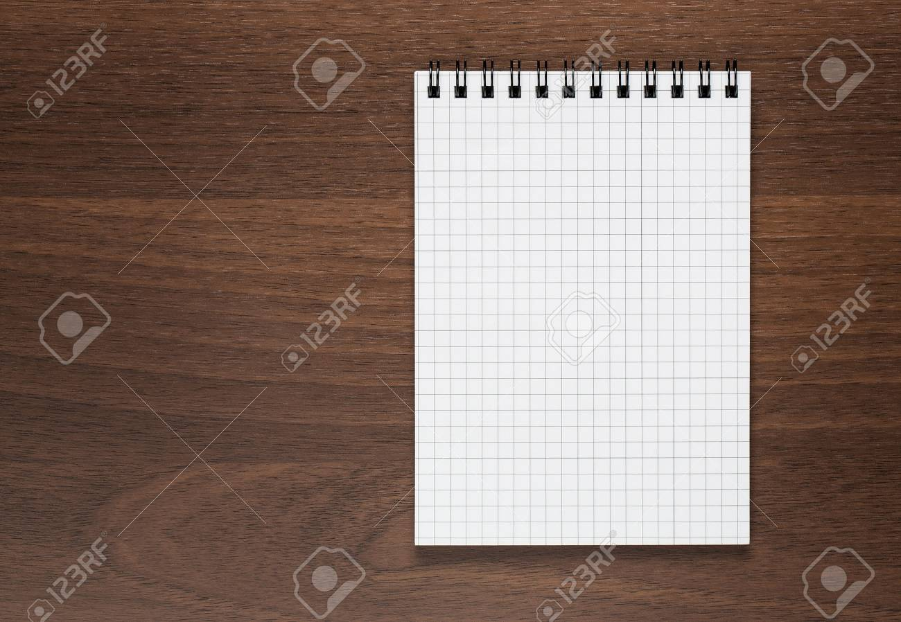 Blank notepad at wooden desk with copy space - 23072161