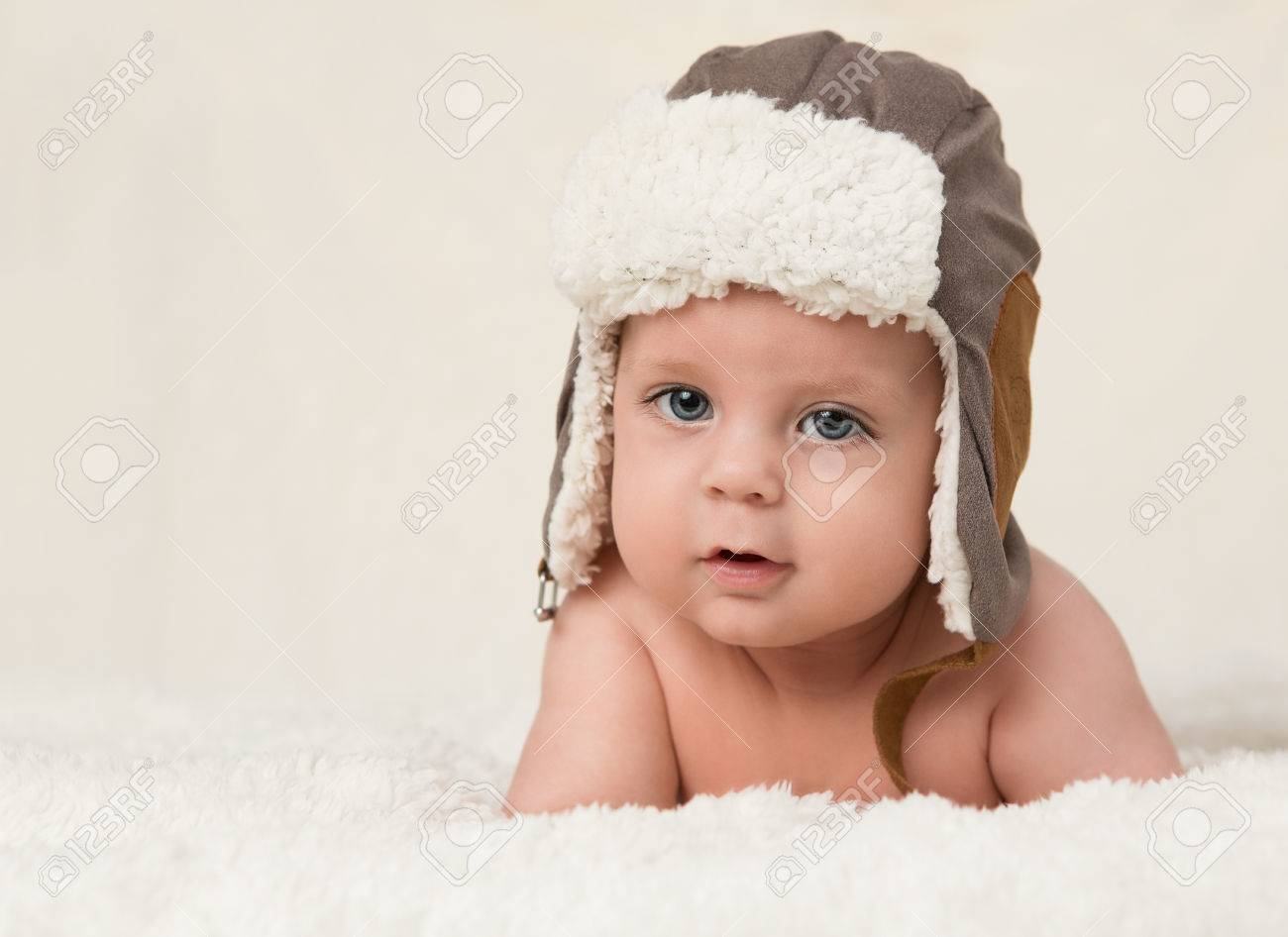 Portrait of a cute baby boy wearing winter hat with copy space Stock Photo  - 24557867 67ef302e34c