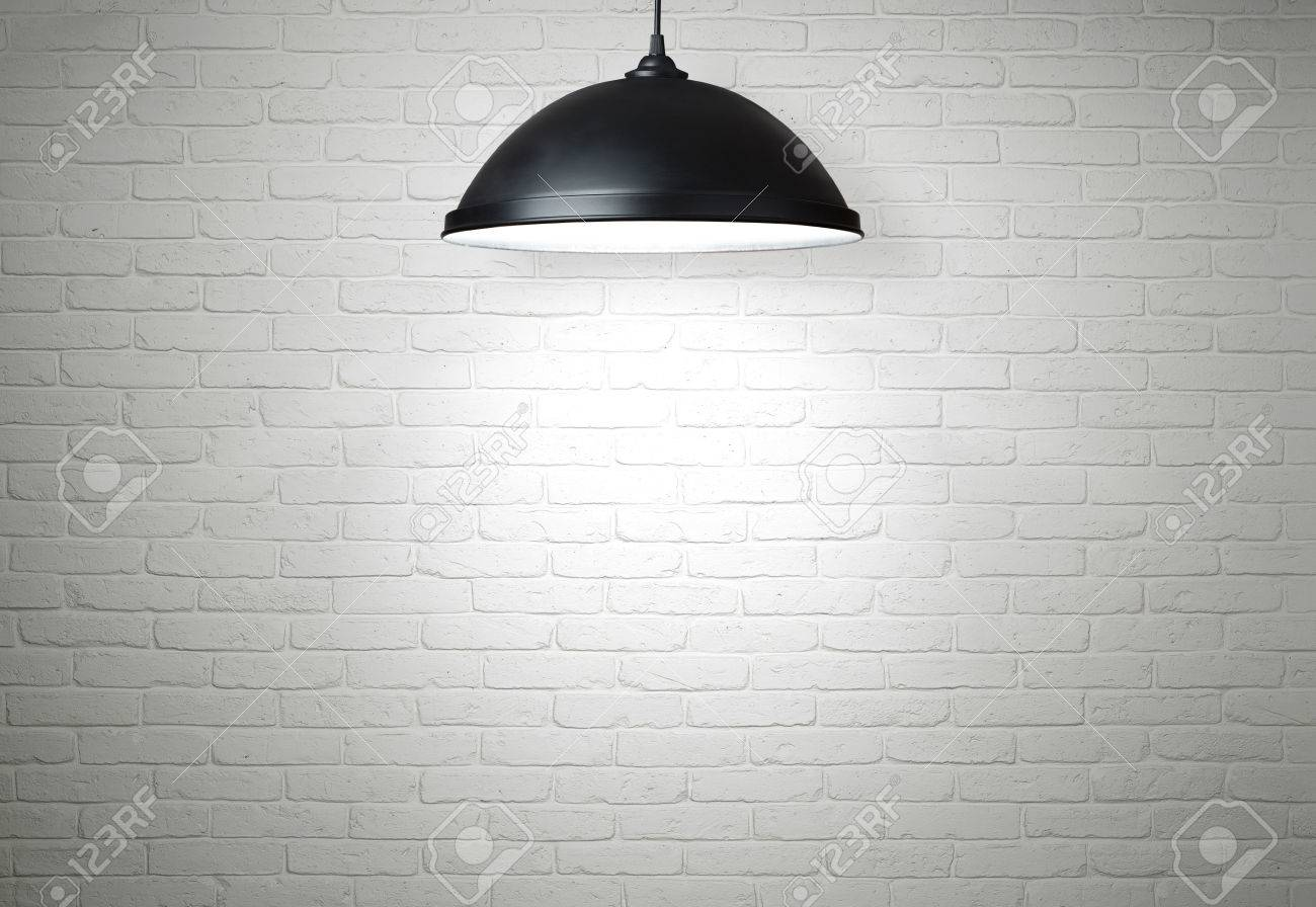 White brick wall illuminated by the lamp with copy space - 24929722