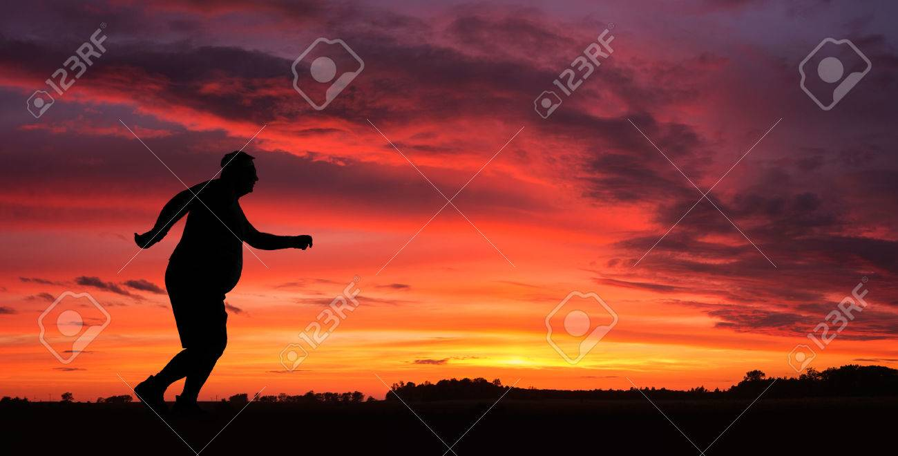 Silhouette of funny overweight man jogging at the sunset - 30213626