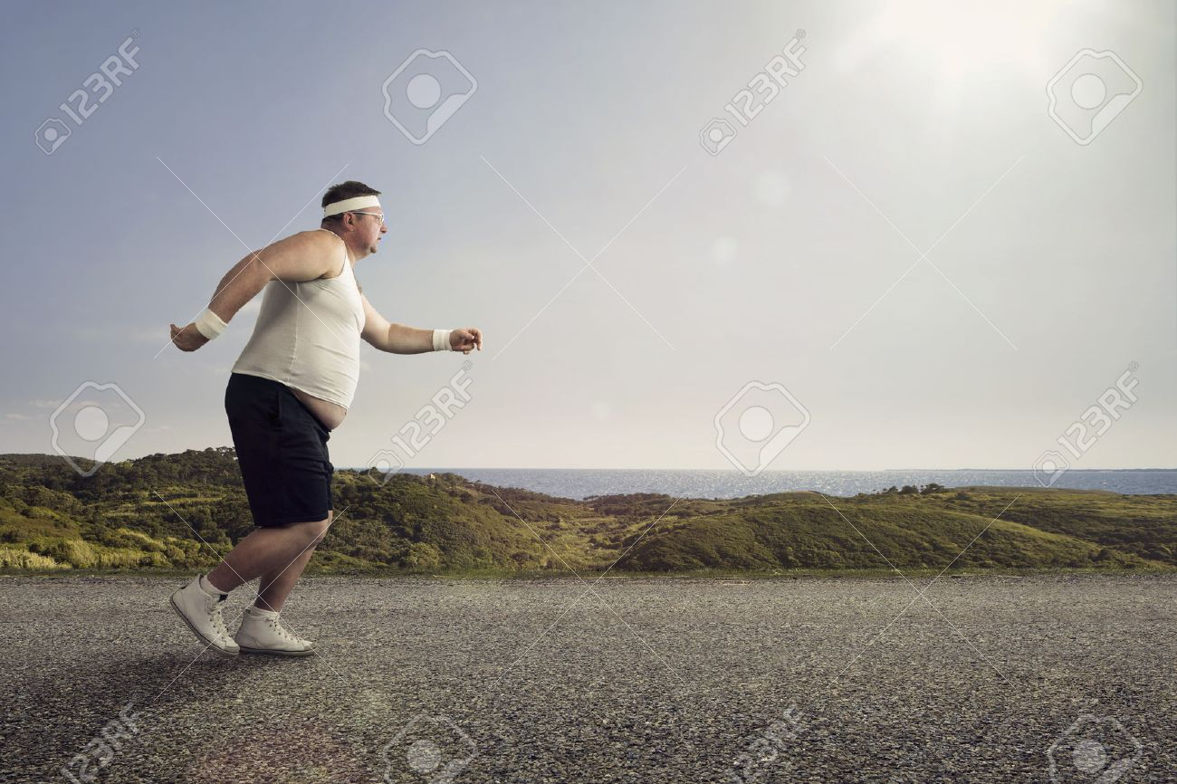 Funny overweight man jogging on the road - 30213629