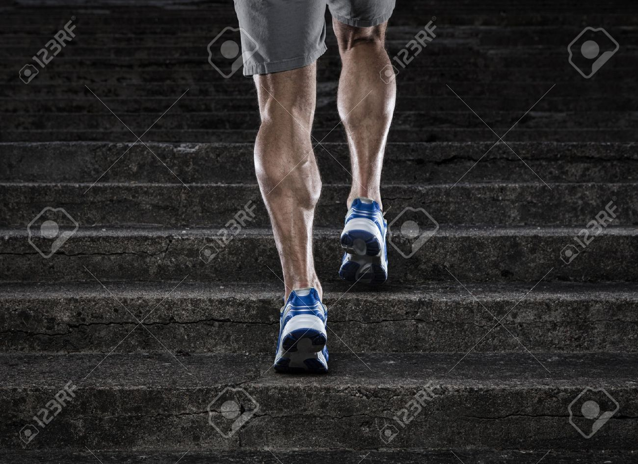 Practice, close up of young man running up the stairs - 30830471